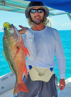 Adam with his catch of the day -