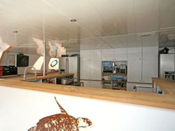 DREAM 82' Yacht Charter - Galley with Bar Area covered by a Hard Bimini