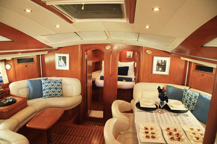 SAYANG Yacht Charter - Saloon lounging area with some snacks!