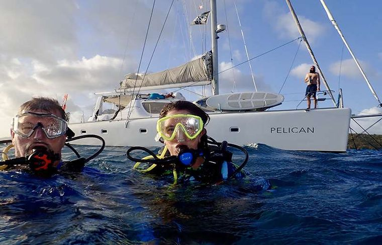 PELICAN Yacht Charter - Surfacing after a dive