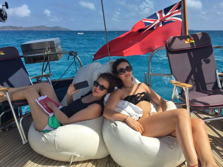 THE DOVE Yacht Charter - Guests Relaxing