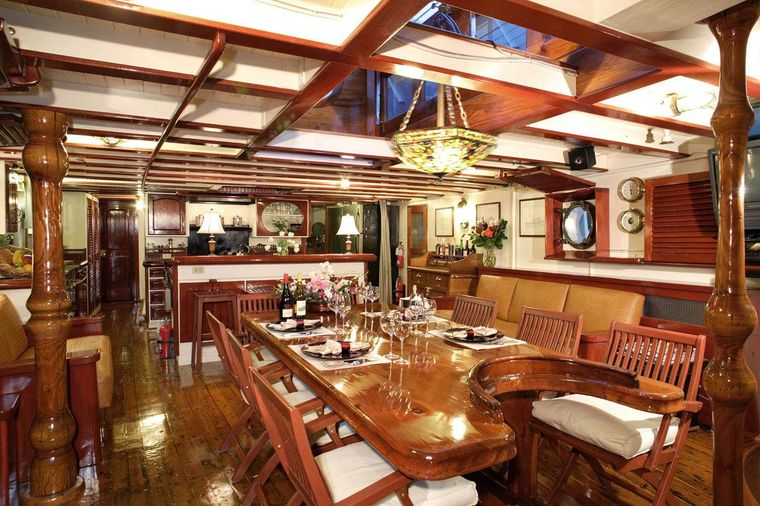 PACIFIC YELLOWFIN Yacht Charter - Main Salon. Country Kitchen in the far end.