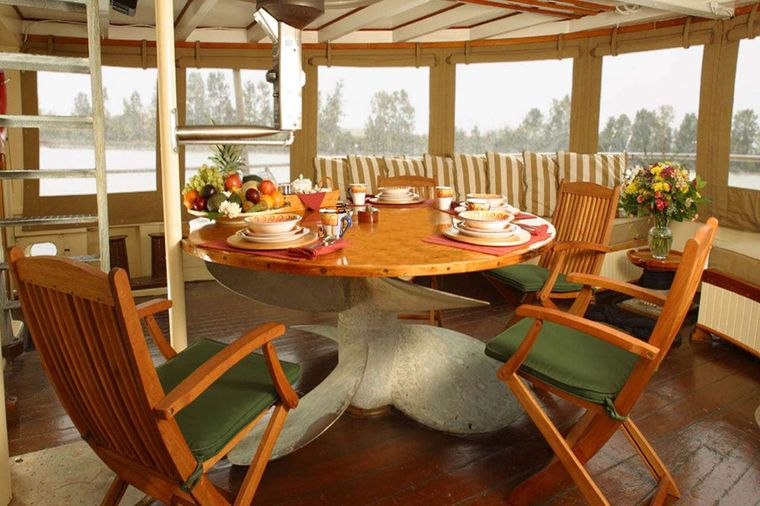 PACIFIC YELLOWFIN Yacht Charter - Aft Deck Dining for 10.  This area can be fully enclosed.