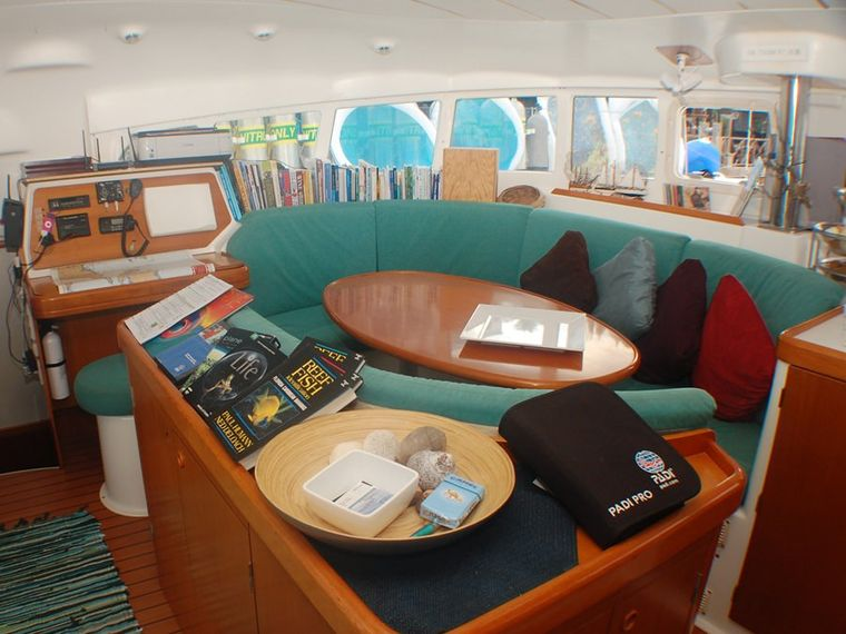 MIMBAW Yacht Charter - Main Salon & Dining has 180 degrees of windows.  Very airy and spacious.