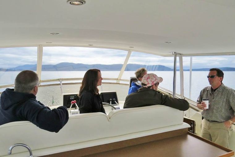 NORTHERN LIGHT Yacht Charter - Top Flying Bridge, seating area facing forward; enclosed in clear panels for comfort in any weather.