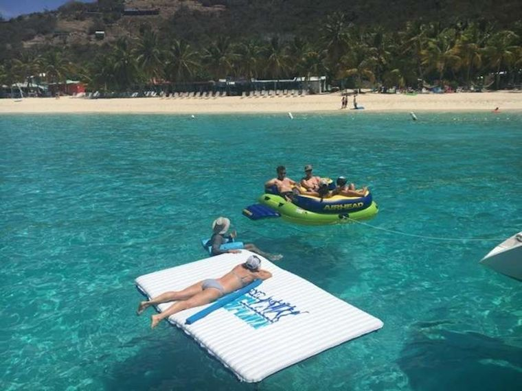 FEEL THE MAGIC Yacht Charter - Guests relaxing on floating mats