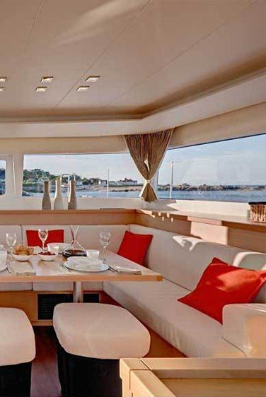 AMELIA Yacht Charter - The main saloon, has table that is large enough to seat 8 guests in comfort.