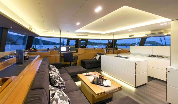 ALETHEIA Yacht Charter - Saloon lounge. Formal dining in cockpit area.