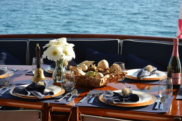 BONAPARTE Yacht Charter - aft deck dinner table set up