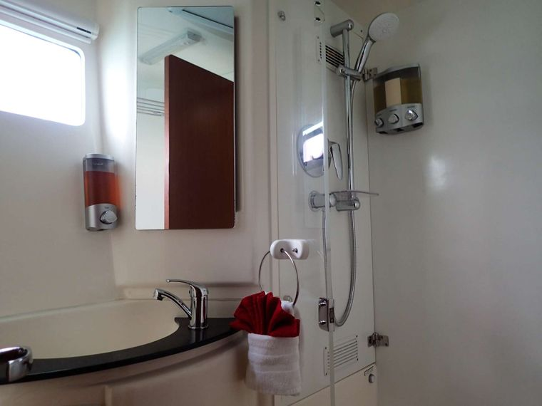 ELIXIR Yacht Charter - Each cabin has private head with separate shower stall