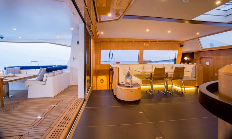 WINDQUEST Yacht Charter - Living Room Opens to Aft Deck