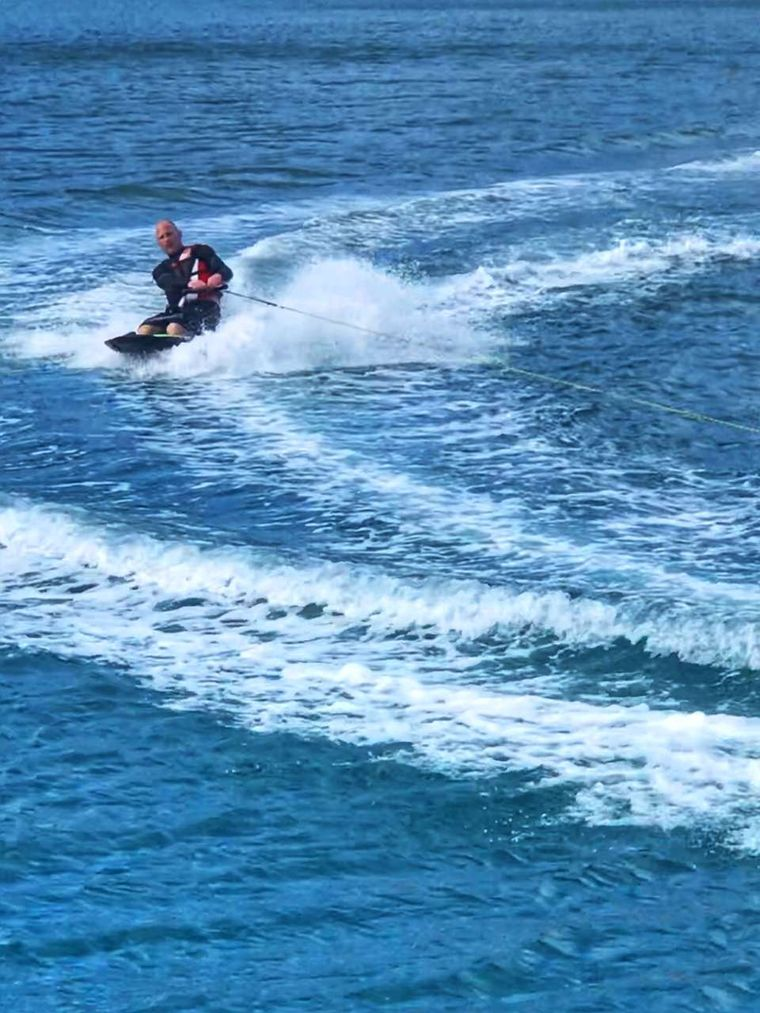 STARFISH Yacht Charter - Kneeboarding! Even big kids get to have watersports fun!  We also have a big tube, wakeboard, and skis for the adventurous.