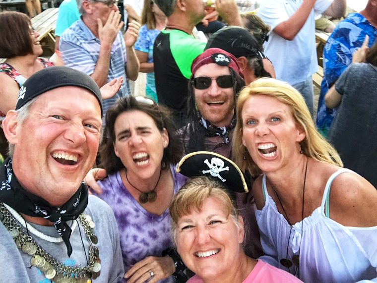 """STARFISH Yacht Charter - Starfish guests enjoying the Michael Beans """"Happy Arrrr"""" show at Leverick Bay.  (And, yes, we have costumes!)"""