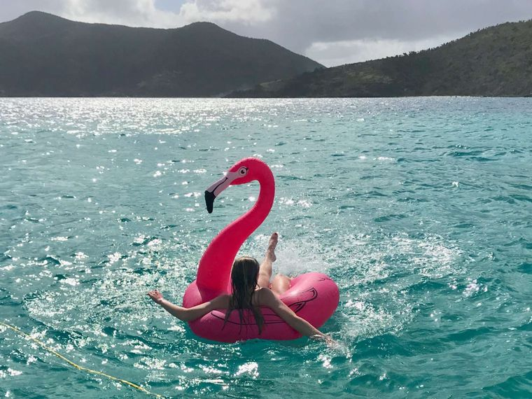 GENESIS II Yacht Charter - Kick back and enjoy the view on our inflatable flamingo