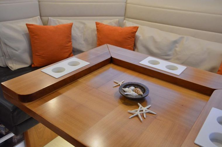 MOJEKA Yacht Charter - Main Salon dining table in lounge/cocktail position