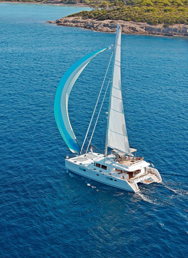 DADDY'S HOBBY Yacht Charter - Spinaker sailing in clear blue waters