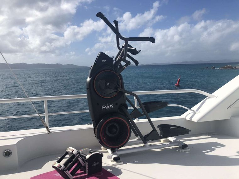 SUITE LIFE Yacht Charter - Workout area includes Elliptical Bow Flex and Free Weights 8 thru 50#'s