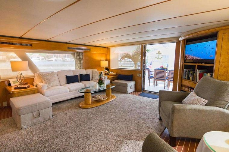 SUITE LIFE Yacht Charter - Salon has 9' Couch, 2 Recliners, 2 Ottomans