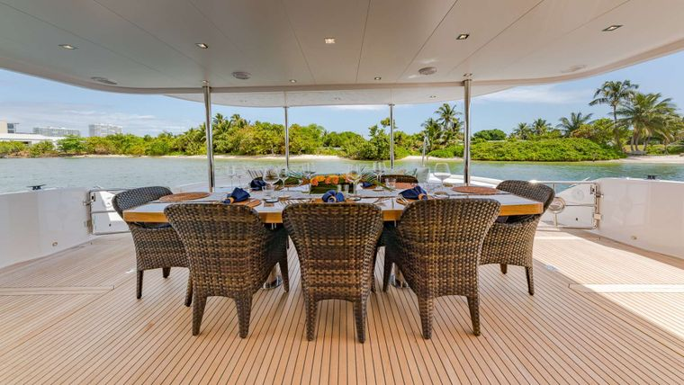 MUCHO GUSTO Yacht Charter - Aft Deck Dining Table