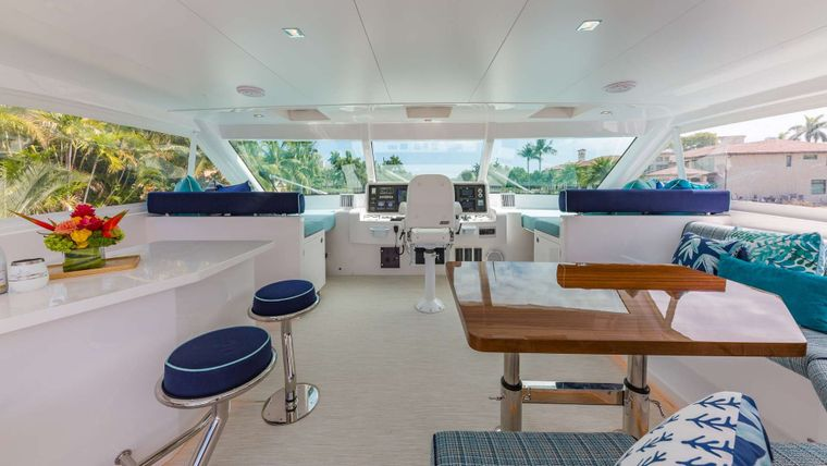 MUCHO GUSTO Yacht Charter - Flybridge Fully A/C'd helm station/ Bar & Dining Area