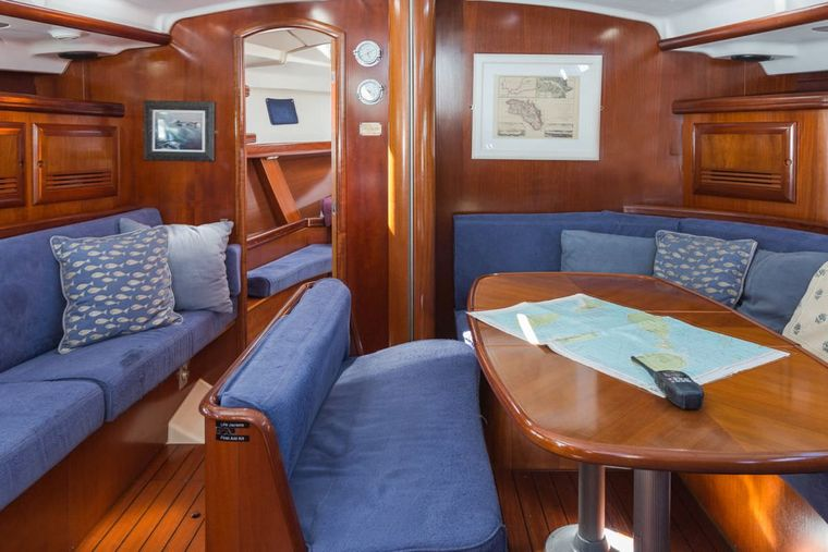 HALF TIDY Yacht Charter - saloon area with dining table