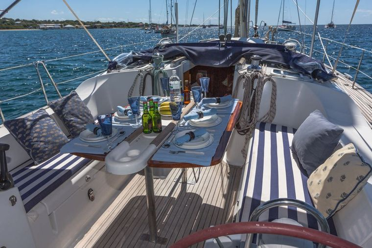 HALF TIDY Yacht Charter - Cockpit with varnished teak table