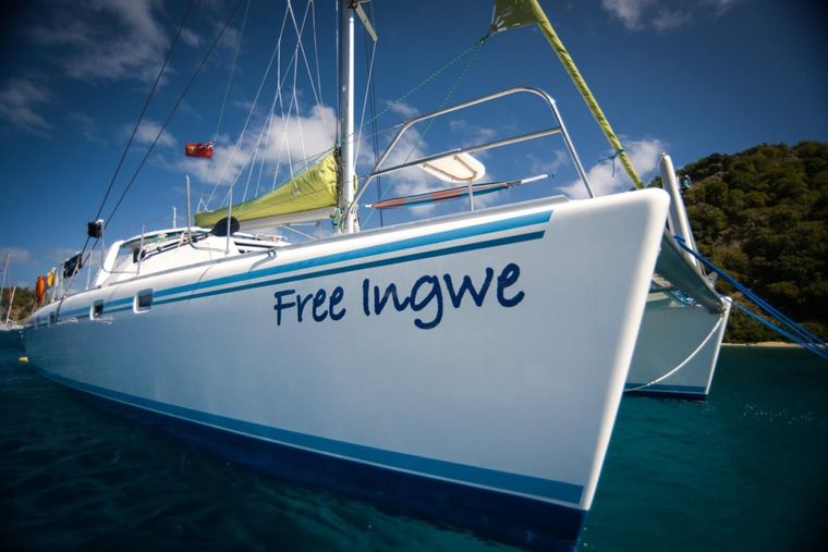 FREE INGWE Yacht Charter - Relaxing on the Bow