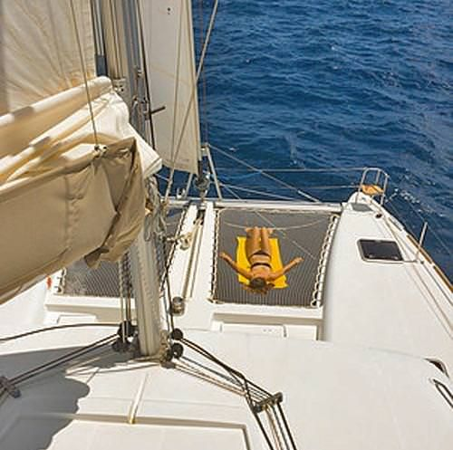 HARMONY Yacht Charter - Chilling out on the trampoline
