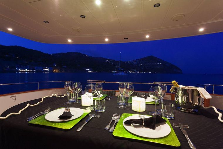WHITEHAVEN Yacht Charter - table dressed up for diner