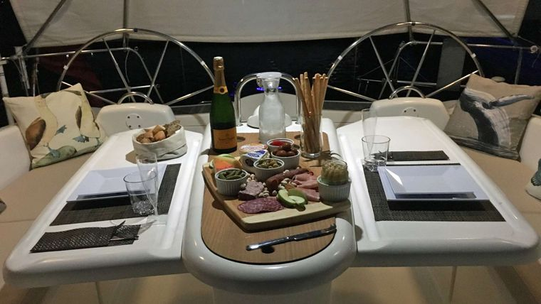 NEMO SY Yacht Charter - Dining in the Cockpit at Sunset