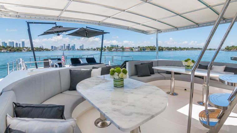 Nirvana Yacht Charter - Flybridge MidShip Table Seating