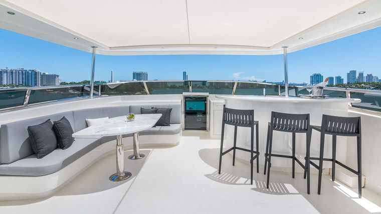 Nirvana Yacht Charter - Flybridge Bow area with Table Seating and Bat
