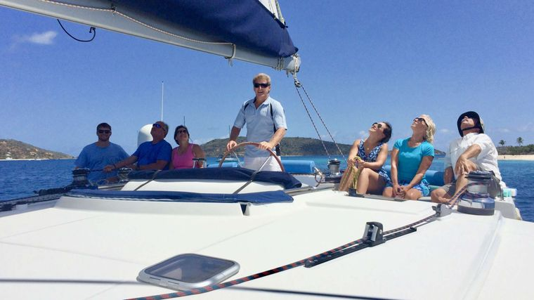 GAMBIT Yacht Charter - Fly bridge and helm seating for the whole party.  The shade Bimini has been lowered for everyone to enjoy the sunshine