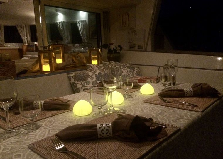 GAMBIT Yacht Charter - Our cockpit seating area is versatile and comfortable.  Day time activities dominate this space until evening when it transforms into a relaxing area set for the evening meal