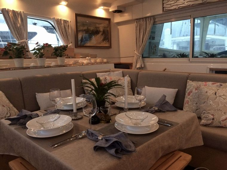 GAMBIT Yacht Charter - Our tastefully decorated saloon area is spacious and comfortable; the ideal place to set up a puzzle, catch up on admin or serve a meal.
