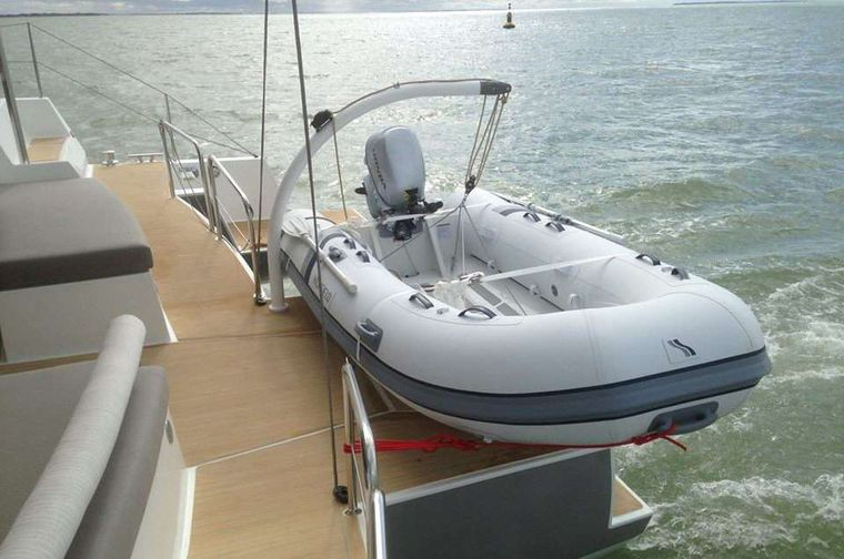 TRILOGY Yacht Charter - Spacious aft deck with tender