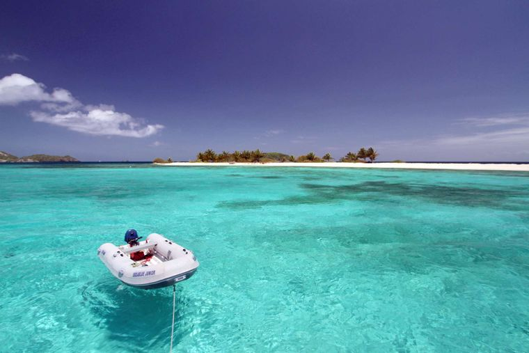 ISOLABLUE Yacht Charter - Our dingy, Junior, in front of Sandy Island