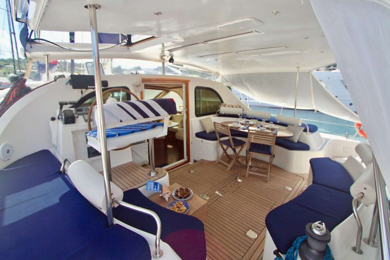 ISOLABLUE Yacht Charter - Aft Deck Dining with sun shades