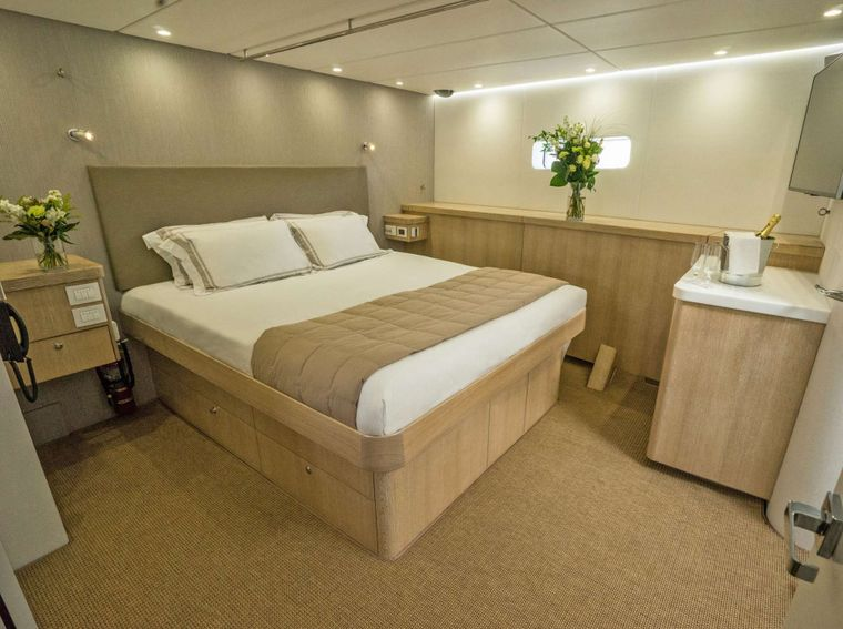 GREY WOLF Yacht Charter - Primary cabin, king bed, ample storage, widescreen TV