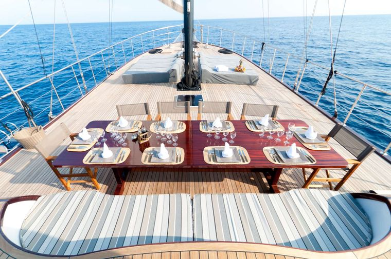 Vita Dolce Yacht Charter - Dining table outside