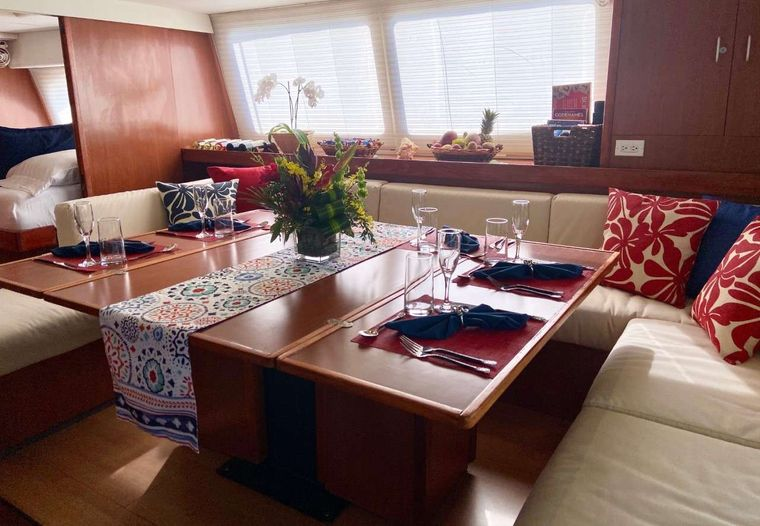 SEA ESTA Yacht Charter - The salon features a cozy dining space with wrap-around seating.