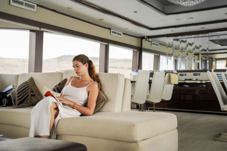 Grand Majestic Yacht Charter - Lounge reading