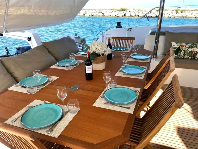 ENCHANTE Yacht Charter - Teak dining table with sun cover deployed