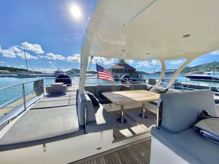 EXCESS Yacht Charter - Flybridge Dining with wrap around sunpads