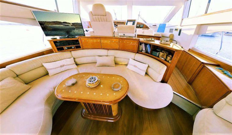 AVENTURA II Yacht Charter - New Curved TV, Apple TV & Table convertible to large dining table