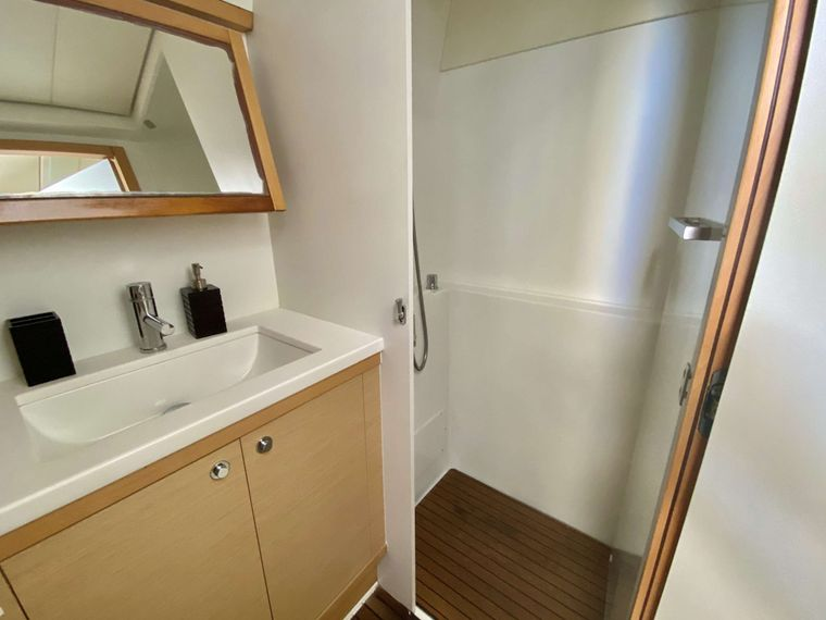 RUMBA Yacht Charter - Guest bathroom with dry shower stall