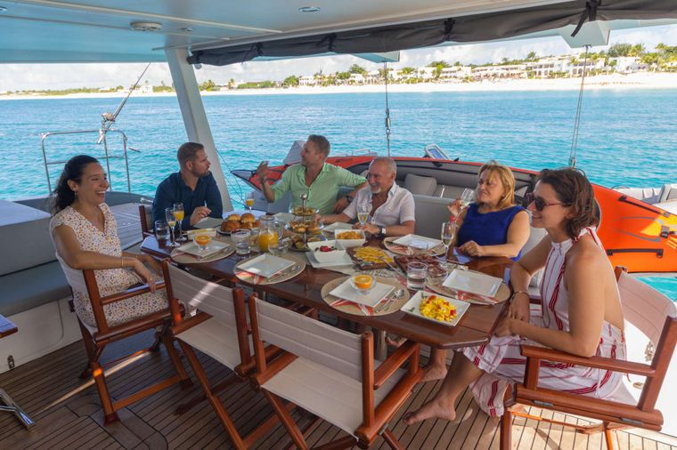 DOLCEVITACAT Yacht Charter - Dining on the aft deck