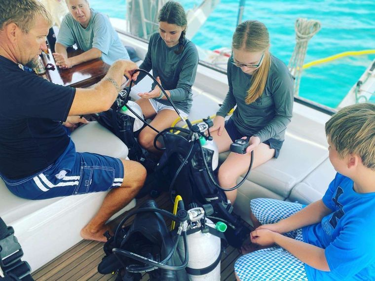 DREAMCATCHER Yacht Charter - Capt Jake with new dive students