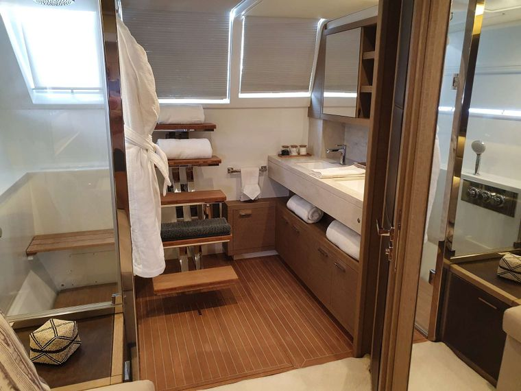 MARE BLU Yacht Charter - Aft Primary Bathroom with access to aft deck