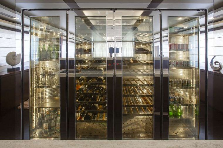 ANDIAMO! Yacht Charter - Salon floor-to-ceiling wine cellar
